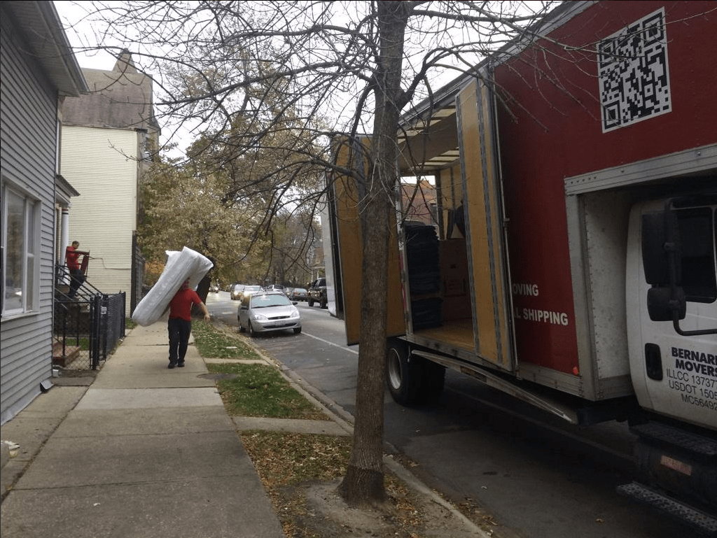 Bernard Movers' team moving furniture in Chicago